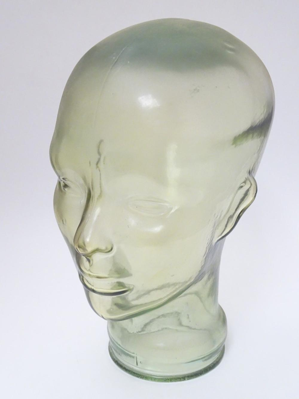 A mid- late 20thC Aqua-glass head, used for hat / wig advertising display, 11 1/2'' high