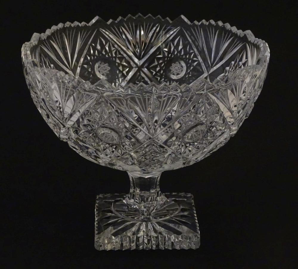 Glass :a cut and pressed moulded lead glass pedestal bowl/tazza with octagonal stem and squared foot