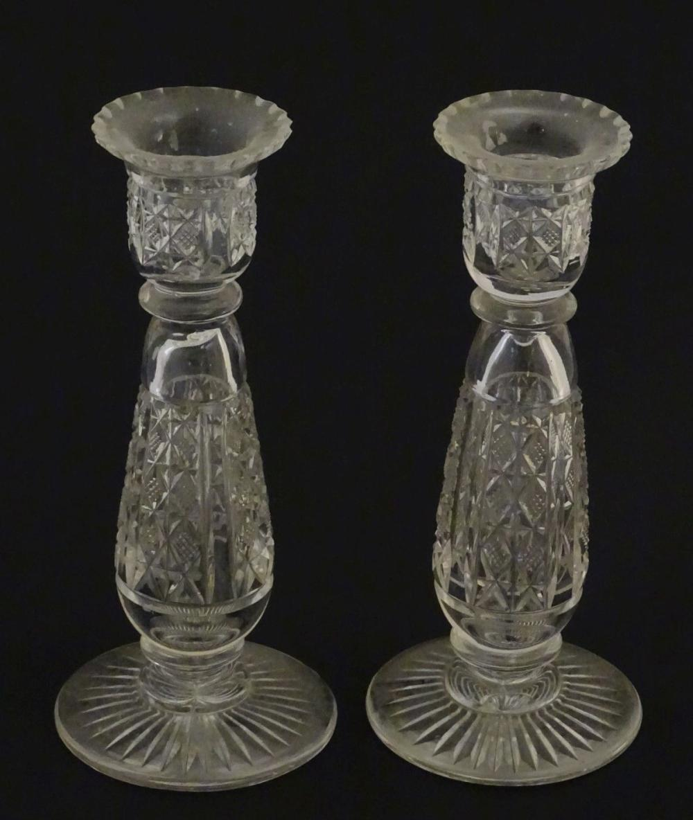 Glass : a pair of cut glass candlesticks with hobnail like decoration and star cut decoration to und