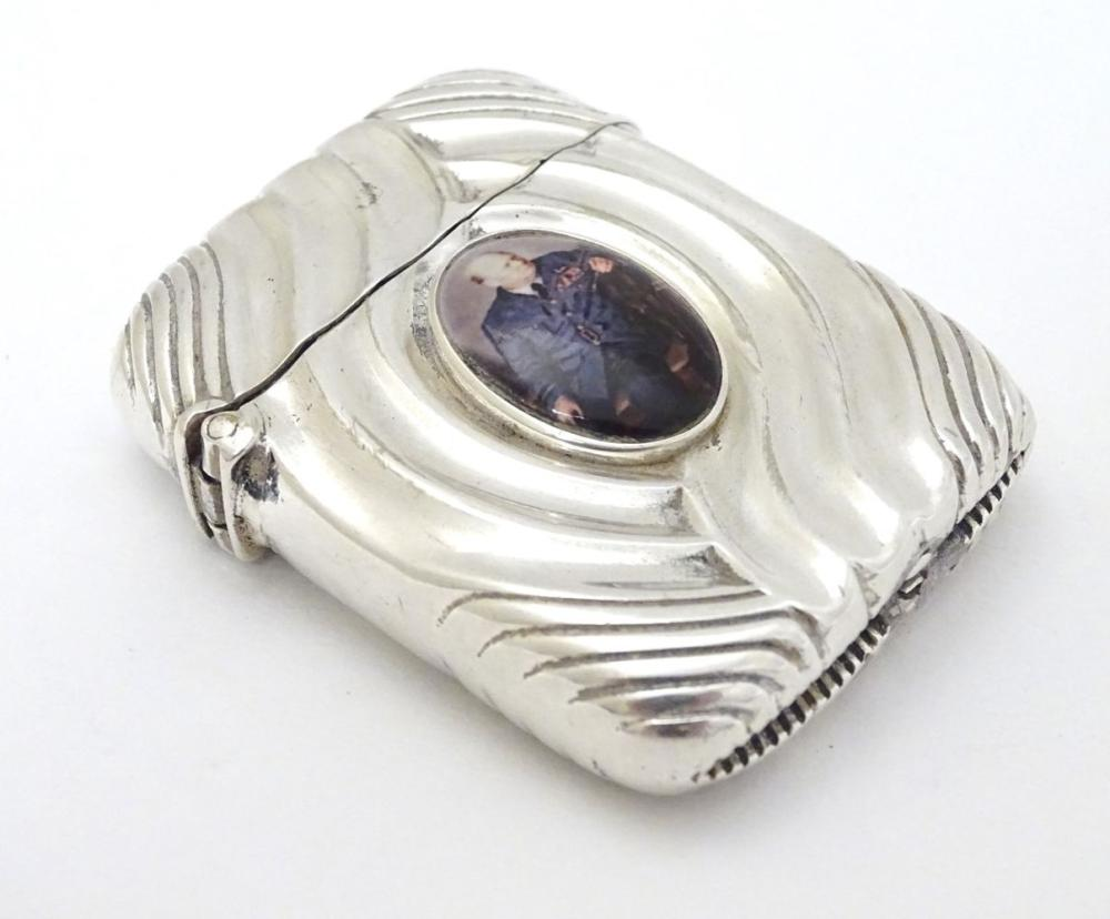A silver vesta case converted to a lighter and with later applied cabochon depicting Winston Churchi