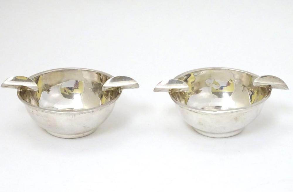 A pair of silver ashtrays hallmarked Birmingham 1939 maker Barker Brothers Silver Ltd. 4'' wide over