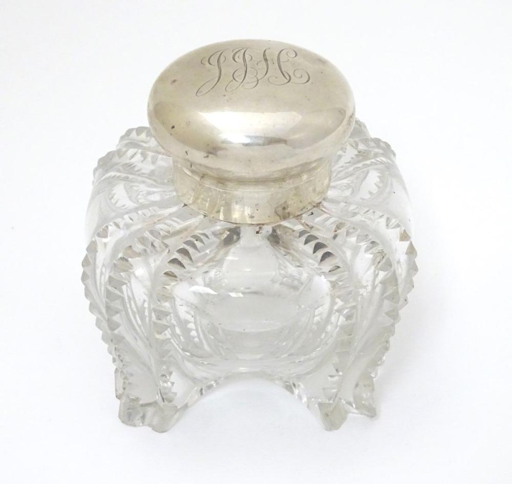 A Victorian glass inkwell with silver top hallmarked London 1897 maker Hukin & Heath. Approx 3 1/2''