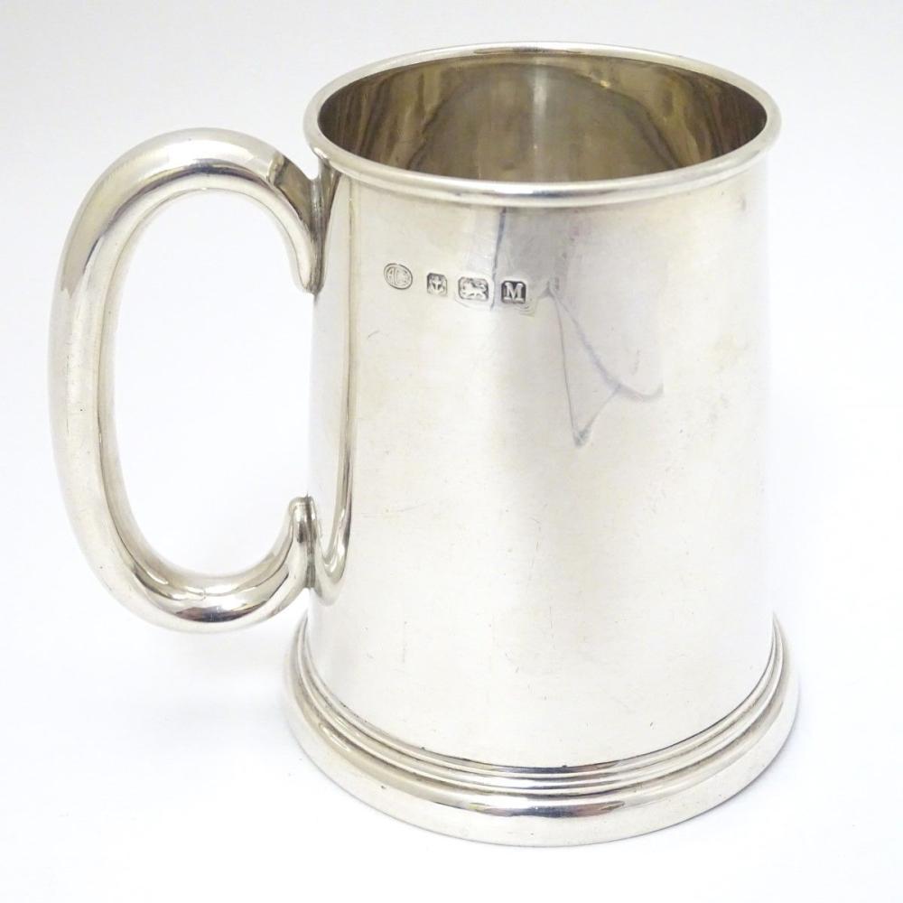 A silver tankard hallmarked Birmingham 1936 maker Alexander Clarke Co. Ltd. 3 3/4'' long (160g)
