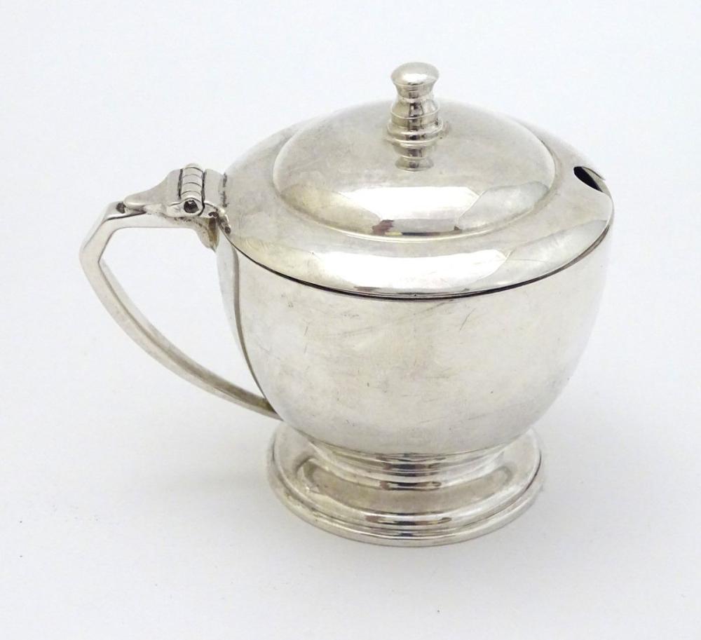 An Art Deco silver mustard pot Hallmarked London 1939 maker Harrods Ltd ( Richard Woodman Burbridge)