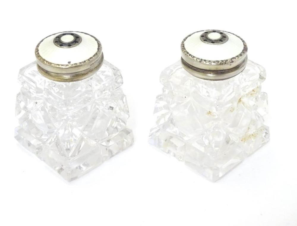 Scandinavian silver : A pair of cut glass pepperettes with Norwegian silver tops having white guillo