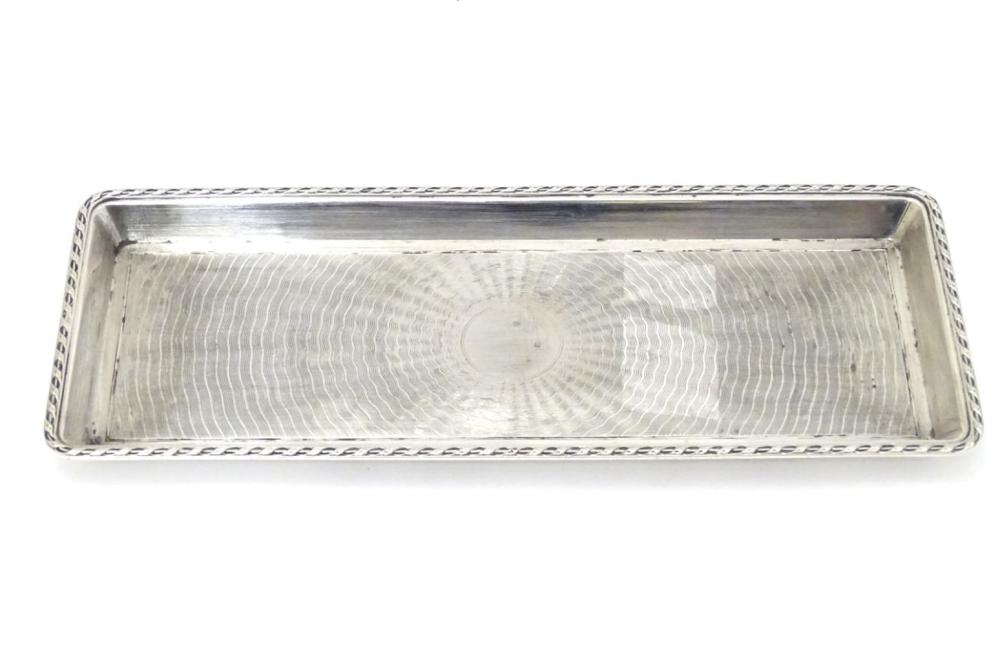 A silver dressing table tray with engine turned decoration hallmarked London 1911 maker Goldsmiths &