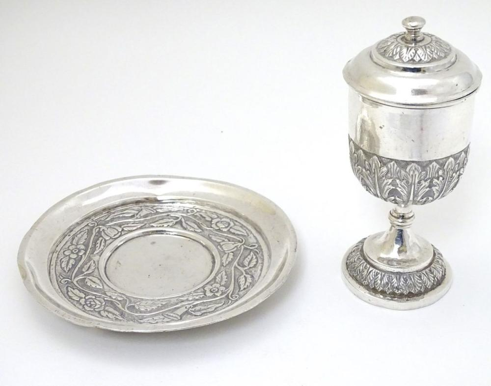 A white metal chalice and cover 5'' high  together with a paten 5 1/4'' diameter (2)