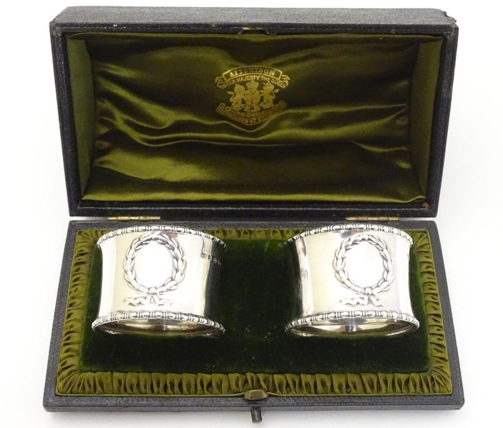 A cased pair of silver napkin rings hallmarked Birmingham 1914 maker Gorham Manufacturing Co.