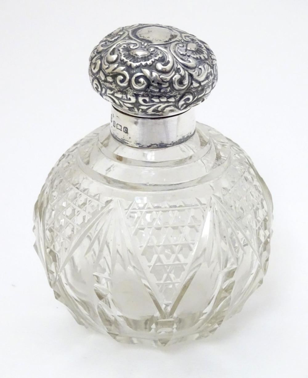 A cut glass scent / perfume bottle with silver top hallmarked Birmingham 1904 4 1/2'' high overall