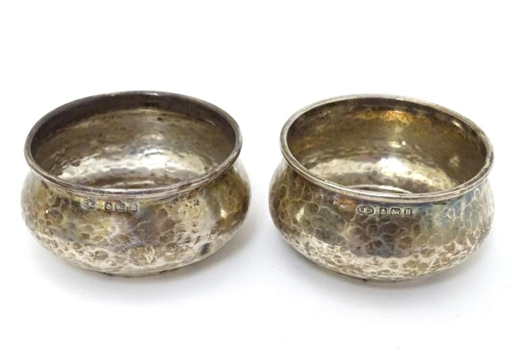 A pair of Art Deco silver salts with hammered decoration hallmarked Birmingham 1923 maker Albert Edw