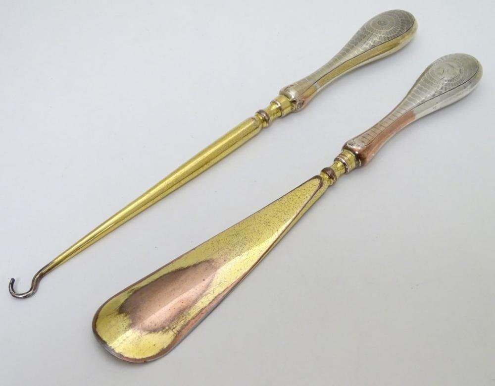 Silver handled button hook and shoe horn with engine turned decoration and traces of gilding. Hallma