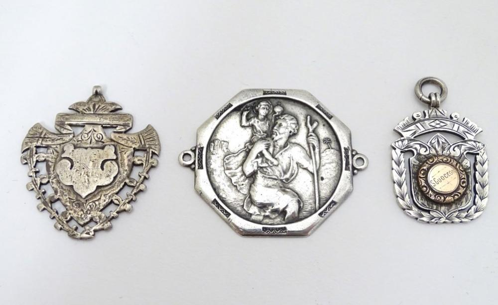 Two silver fobs hallmarked Birmingham 1894 and Birmingham 1907. Together with a medallion depicting