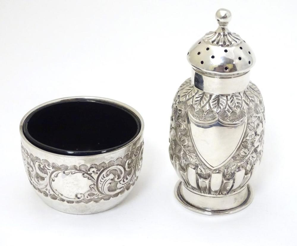 A Victorian silver embossed pepper pot hallmarked 1888 maker E S Barnsley & Co 3 1/2'' high. Togethe