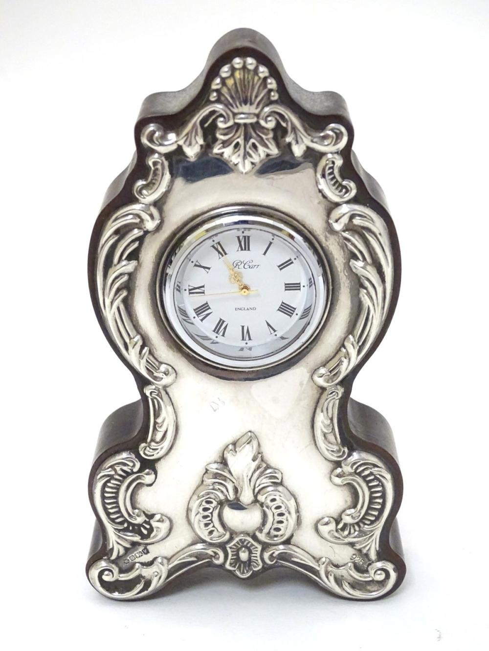 A mantle clock with silver mounts hallmarked Sheffield 1988 maker Carrs of Sheffield 5 1/4'' high