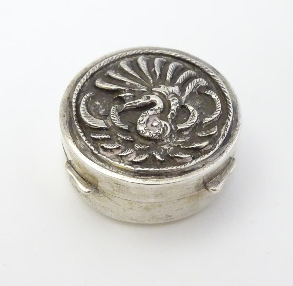 A Continental white metal pill box of circular form 1 1/4'' diameter