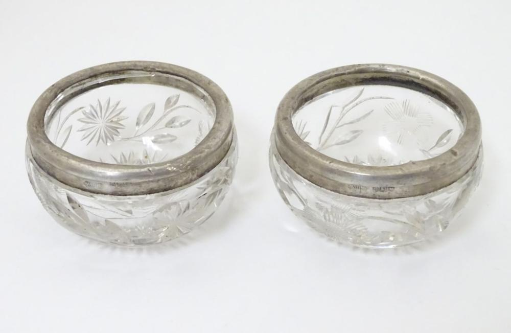 A pair of cut glass salts with silver rims, hallmarked London 1913 maker William Henry Sparrow 2 1/2