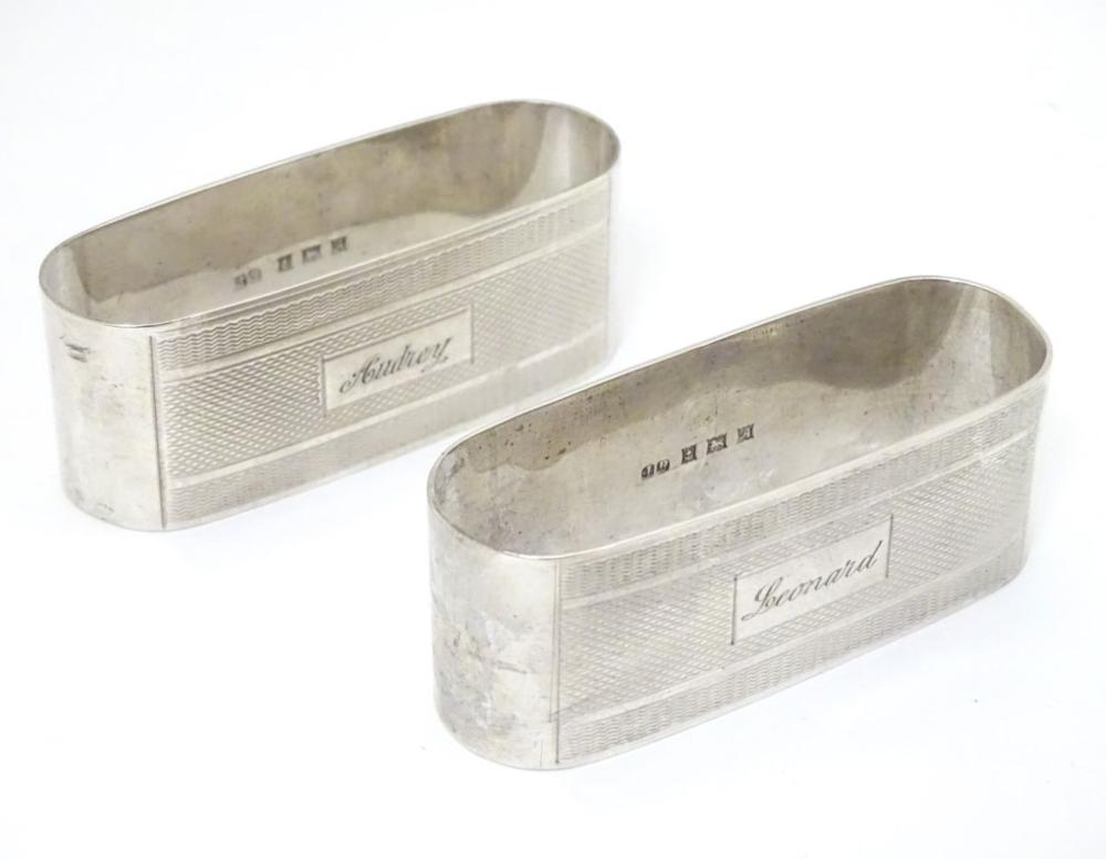 A pair of silver napkin rings with engine turned decoration hallmarked Birmingham 1950 maker John Ro