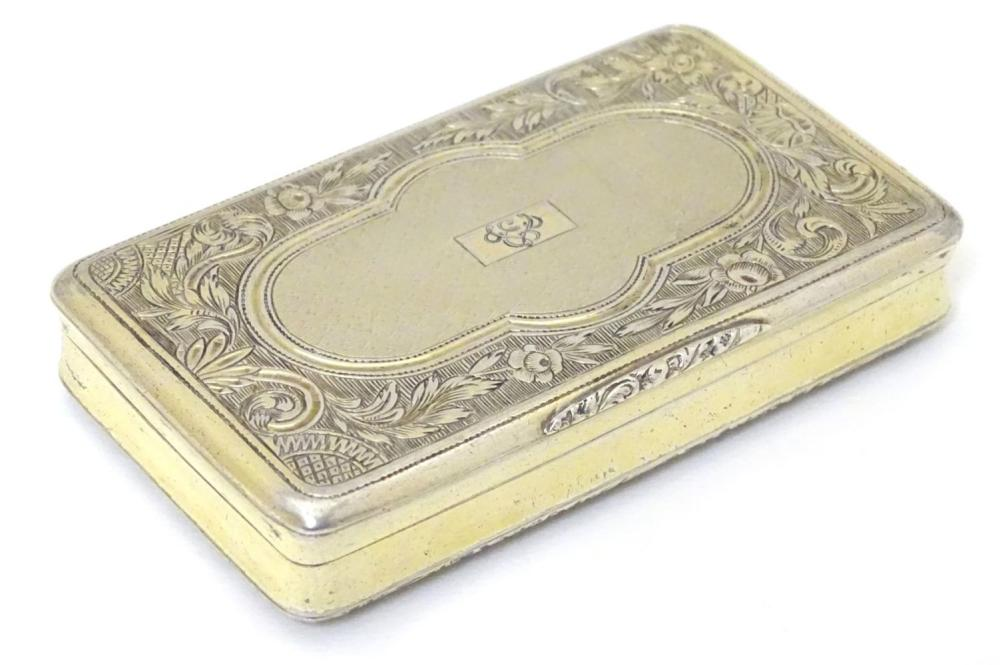 A 19thC Continental (.800) silver gilt snuff box with engine turned decoration, bears Mark for Kingd