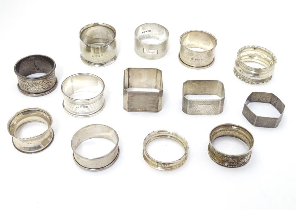 13 assorted silver napkin rings various dates and makers, some with engine turned deocration, togthe