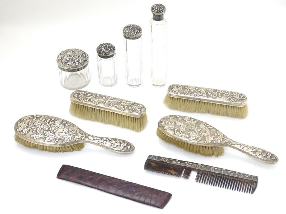 Assorted dressing table items comprising 2 brushes hallmarked London 1900, a brush hallmarked 1894,