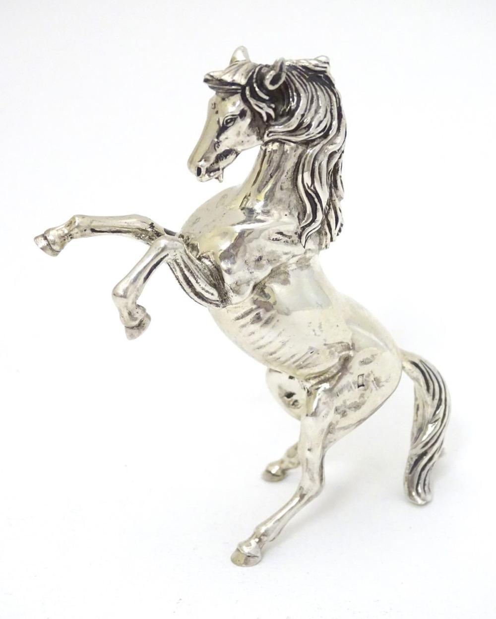 An Egyptian silver model of a horse 4'' long