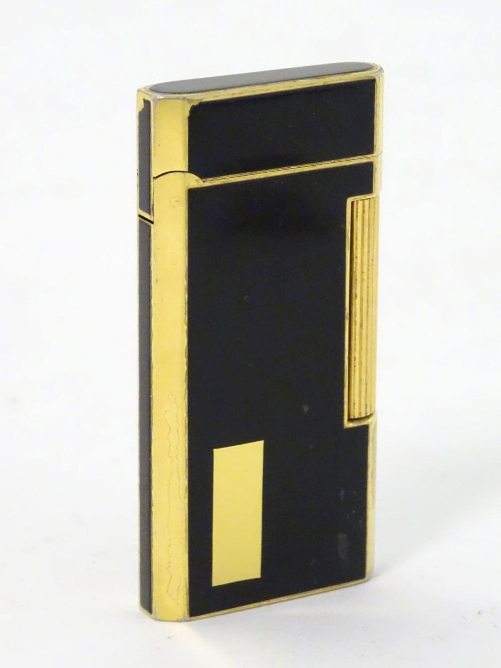 48447afd2 A black lacquer and gold plated Ronson roller cigarette lighter. Approx. 2  1/