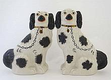 A pair of Victorian Staffordshire spaniels having