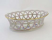 A Herend chestnut basket of oval shape, the sides