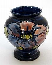 A Moorcroft pottery style tube lined squat vase