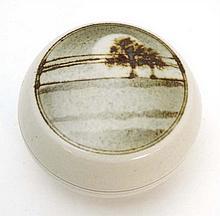 A small stoneware circular pot and cover,