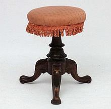 A Victorian walnut adjustable height tripod piano stool.