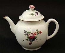 An 18thC Worcester Dr Wall period tea pot , decorated in polychrome with sp