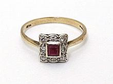 A 9ct gold ring set with central ruby bordered by diamonds in a squared set