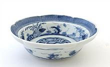A Chinese porcelain 2-lobed bowl decorated to