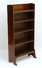 An early 20thC freestanding five shelf bookcase with raised inlaid back sta