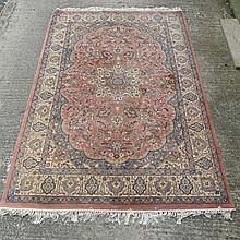 Rug / Carpet : an Indian Kaimuri carpet with buff , yellow and violet centr