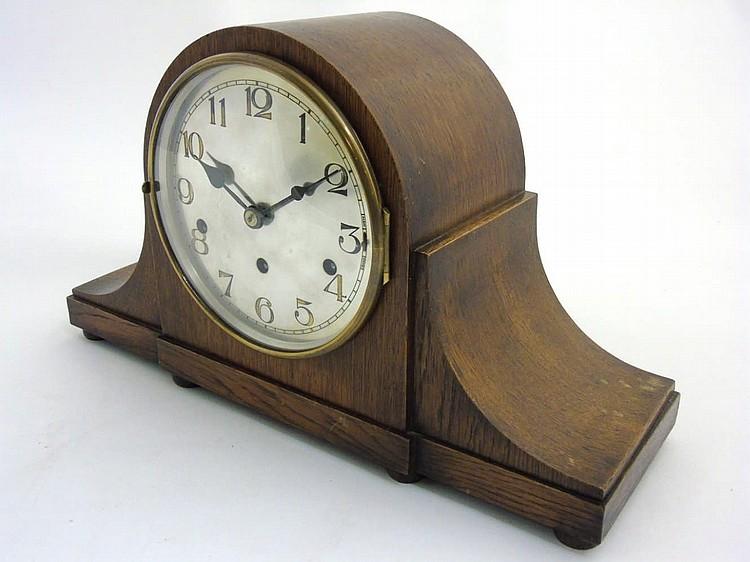 Napoleon hat mantel clock :An oak cased Kienzle 3