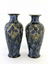 A pair of Royal Doulton stoneware vases of