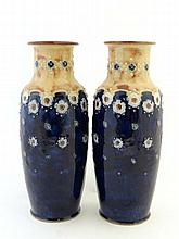 A pair of Royal Doulton Vases of baluster shape by