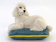 A Royal Doulton model of a white Poodle seated on