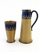 A Doulton Lambeth stoneware jug and beaker by