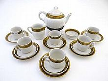 A Miniature Tea Set, white china with gold gilt