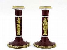 A pair of 19thC pottery candlesticks decorated