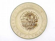 A Victorian motto plate with moulded alphabet