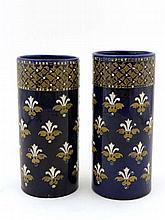 A pair of cobalt blue tapered vases, having white