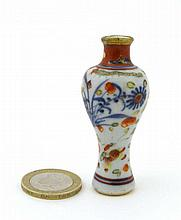 A miniature Oriental vase of baluster shape