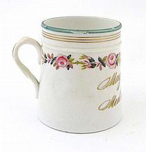 A Victorian Porcelain Mug, gold gilt motto which