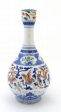 A Chinese porcelain bottle vase decorated with