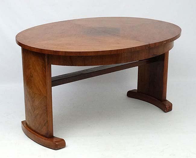 Art Deco : a Walnut 1/4 opposing veneered oval dining table bearing label