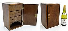 A late Georgian stained oak locking cabinet opening to reveal 6 (front to b